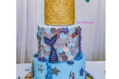A chocolate, vanilla and strawberry Birthday Cake