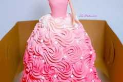 A pink Doll Birthday cake